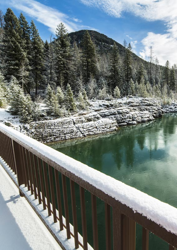 A view of the Flathead River and snow covered trees from the Old Belton Bridge