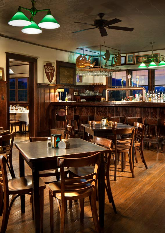 The Belton Chalet Tap Room with wooden interior detailing, tables and chairs