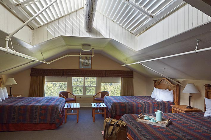 Main Lodge family room at Glacier Park Lodge with three queen beds