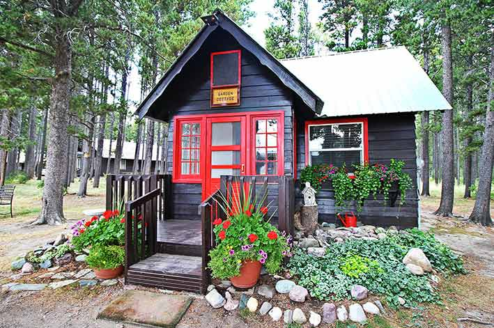 Garden cottage surrounded by flowers at Glacier Park Lodge