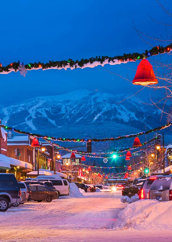 Downtown Whitefish, Montana, decorated for Christmas with lights and garlands.