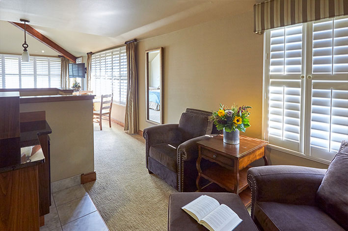 Well-appointed, modern hotel room suite spacious sitting area