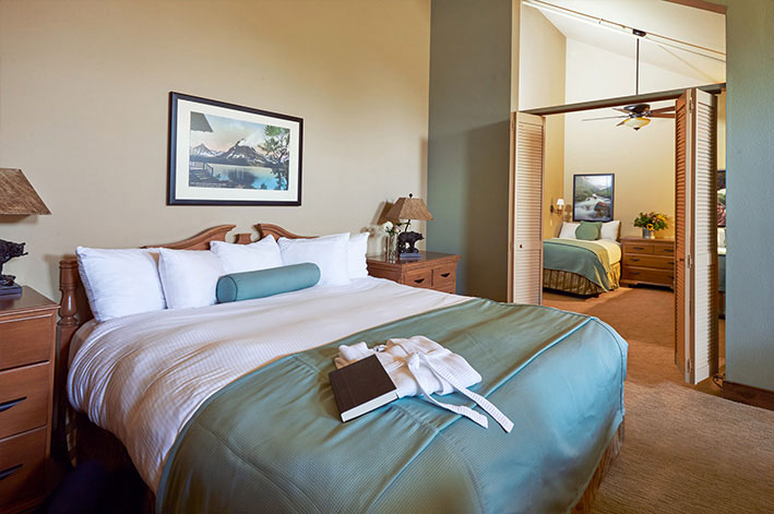 Well-appointed, modern loft hotel room with one king bed and two twin beds in a separate room