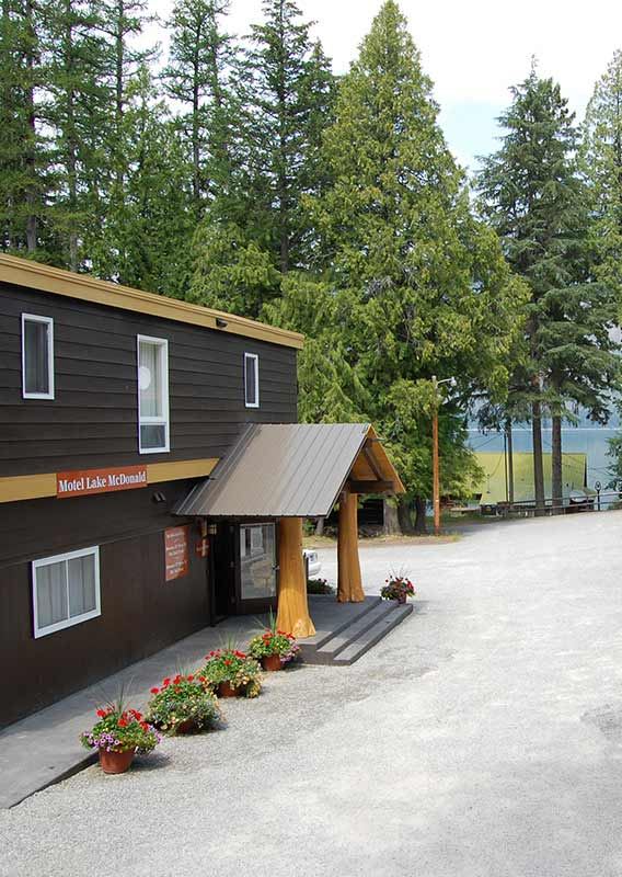 Motel Lake McDonald, surrounded by trees, overlooking Lake McDonald