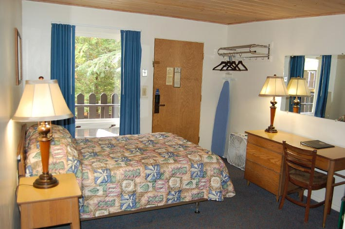 Motel Room at Motel Lake McDonald with one double bed and small desk