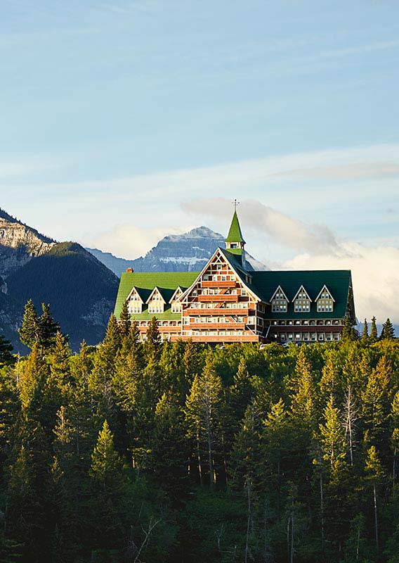 The Prince of Wales hotel sits underneath mountains