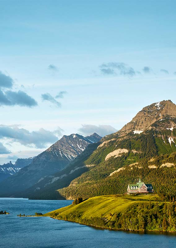 Prince of Wales Hotel on the bluff overlooking Upper Waterton Lake with a dramatic mountain backdrop