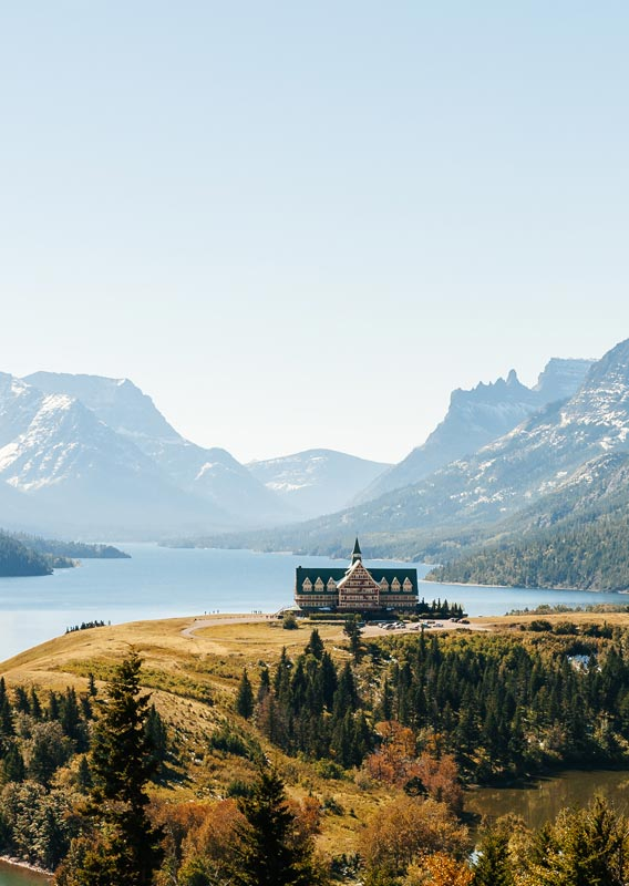 Prince of Wales Hotel on the bluff overlooking Upper Waterton Lake, with mountains across the lake