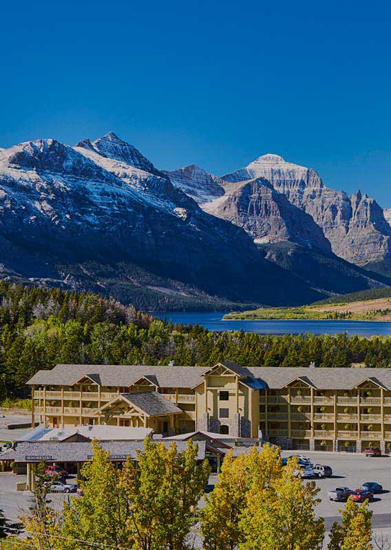 St. Mary Village Lodge with St. Mary Lake and Glacier National Park in the background
