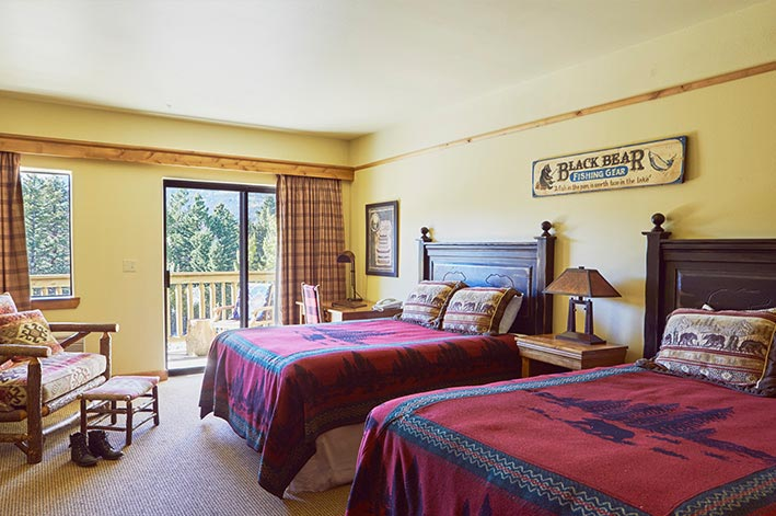 Great Bear Lodge Room at St. Mary Village featuring a private balcony and two queen beds