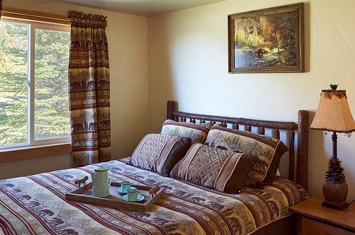 Room with one queen bed in the Glacier Cabins at St. Mary Village