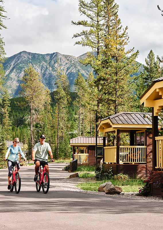 couple cycles through the West Glacier Cabins