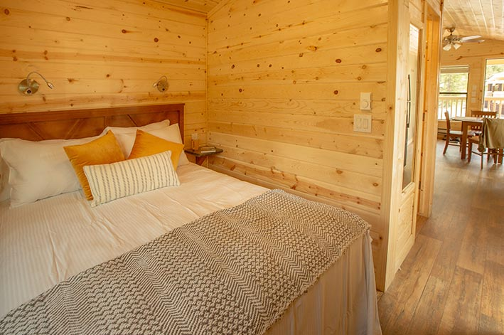 A bedroom in a wooden cabin.