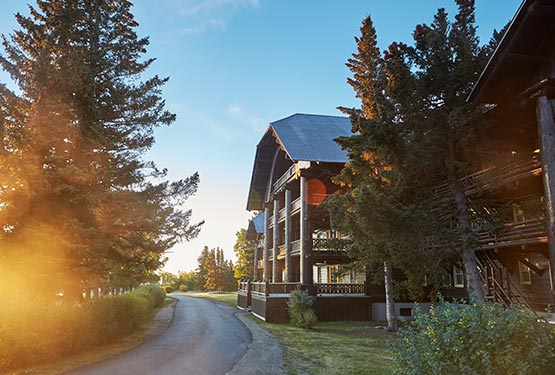 Sun shines against the historic Glacier Park Lodge