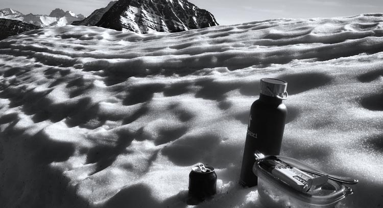 Waterbottle resting in the snow