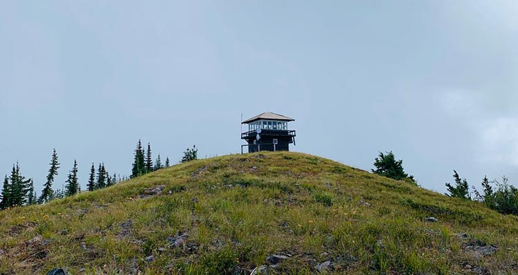 A lookout tower atop a hill.