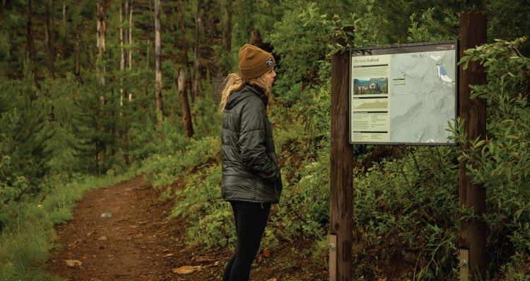 Woman Reading Trail Map